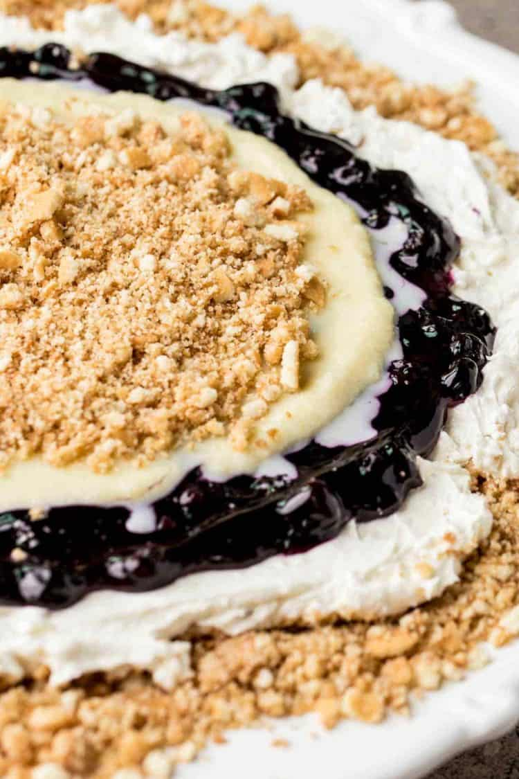 Vanilla wafers blueberry dessert recipe on a platter. Layers of wafers, blueberry pie filling, and sweet cream.