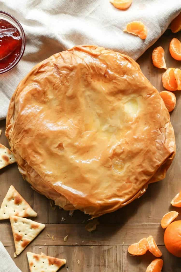 Fillo (phyllo) dough with brie cheese on platter.