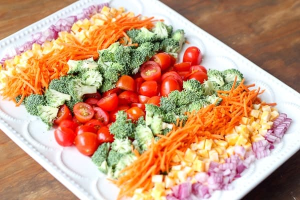 Broccoli cheese tomato salad recipe made with a garlic mayo dressing!