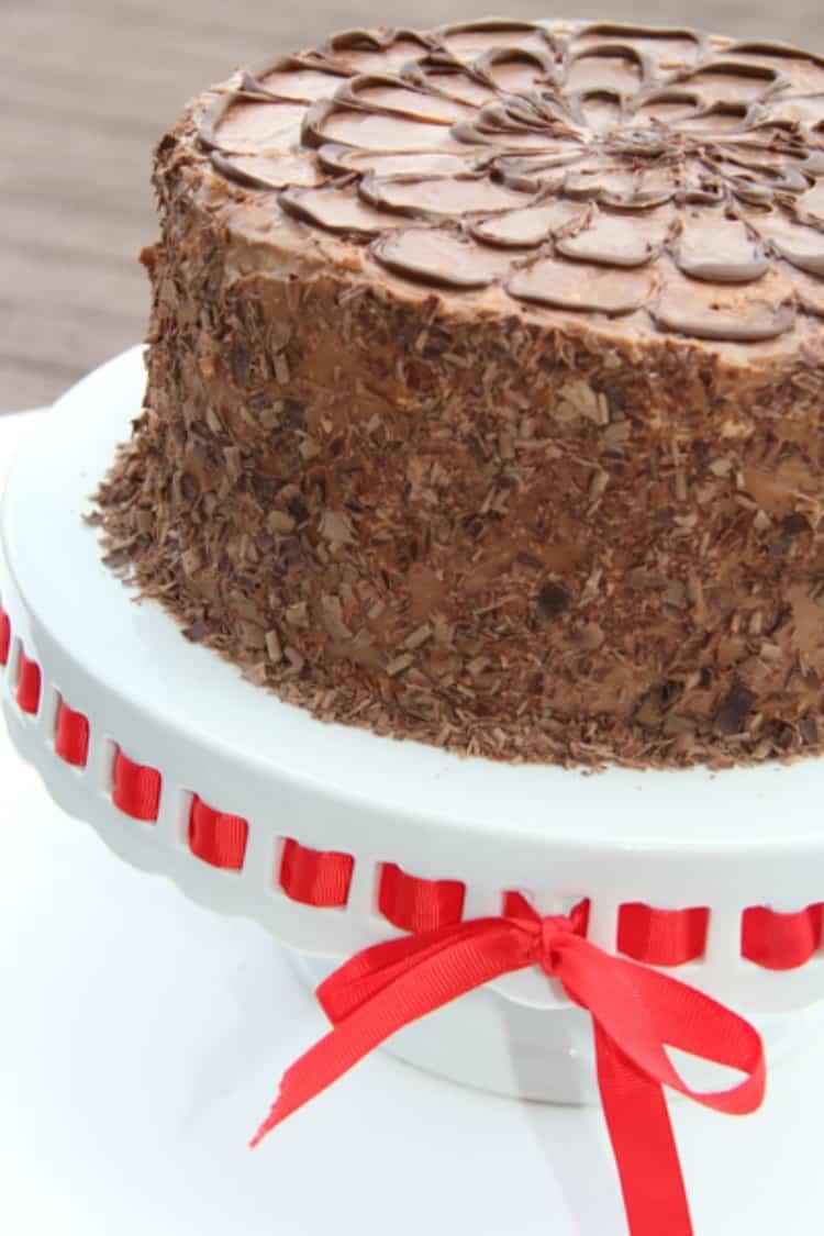Layered meringue chocolate cake on a platter.