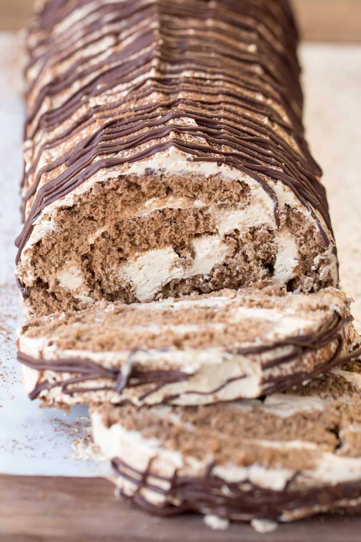 Chocolate Coffee Roulade pieces with chocolate drizzle.