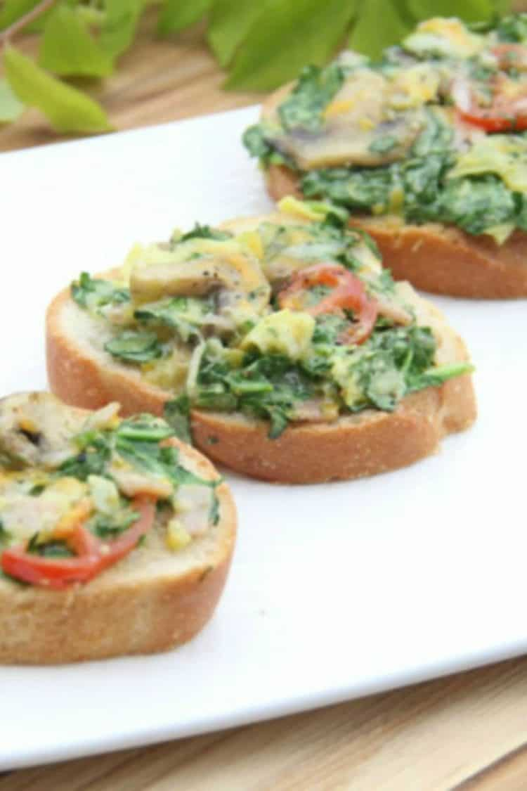 Spinach and Artichoke Canapes on a platter.