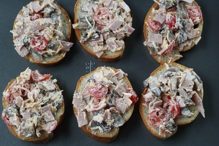 Ham Mushroom Cheese Open Faced Sandwich on a baking sheet.