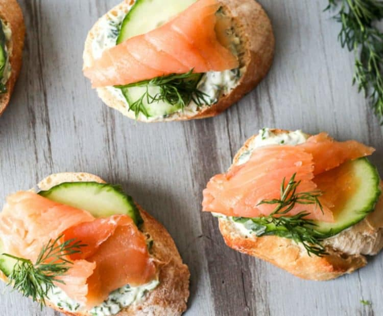 Salmon canapes topped with cucumbers and fresh dill.