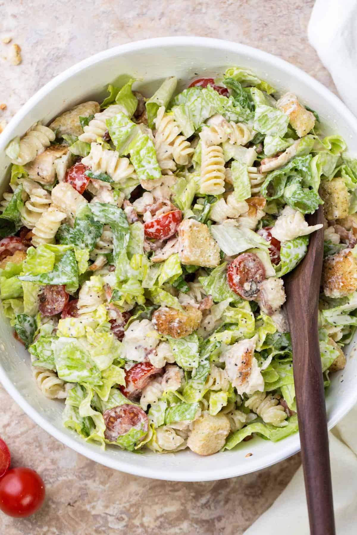 Pasta chicken Caesar salad recipe with a homemade Caesar salad dressing.