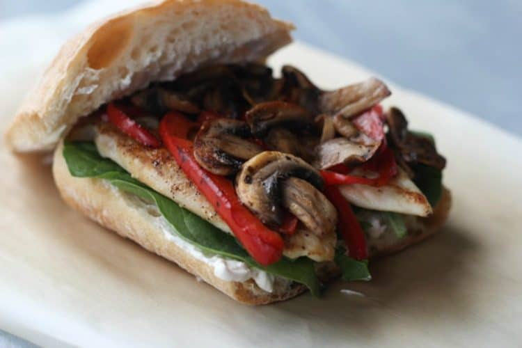Chicken Sandwich Recipe. Chicken sautéed peppers and mushroom on parchment paper.