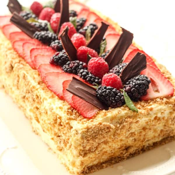 No bake layered cake recipe with fruits on top.
