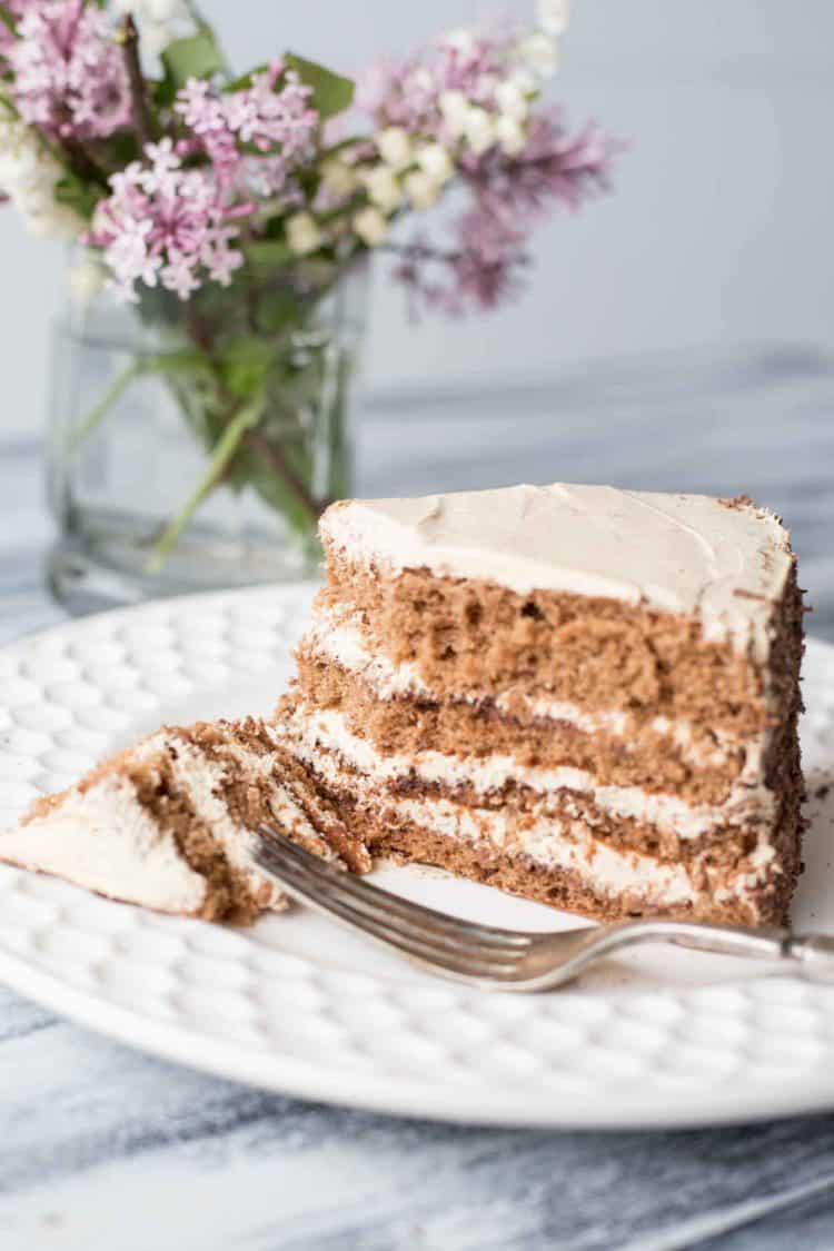 Chocolate cake recipe with coffee cream in a plate with a fork.