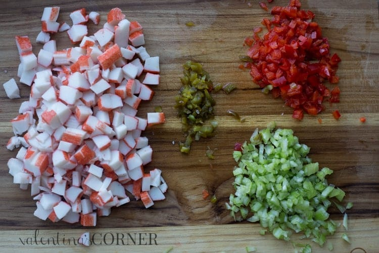 How to cut the ingredients for crab dip. crab, jalepeno, pepper, and celery chopped.