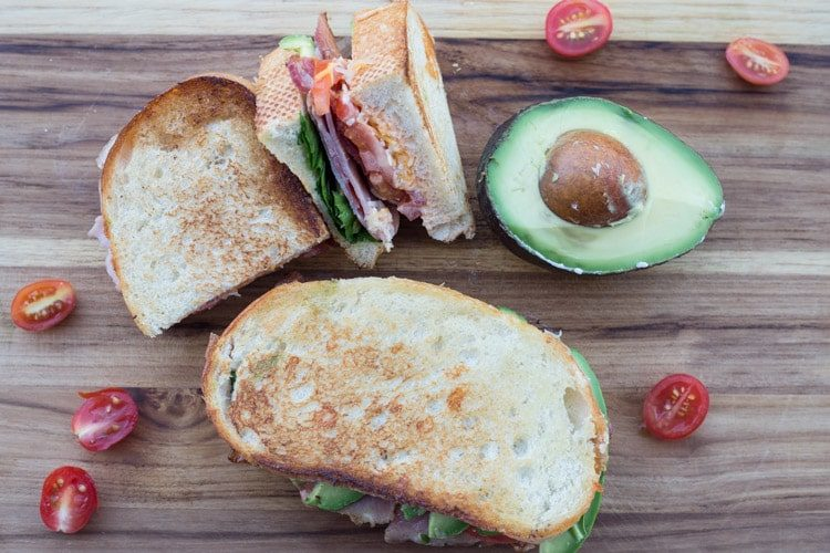 Chipotle Bacon Avocado Sandwich with avocado and tomato.