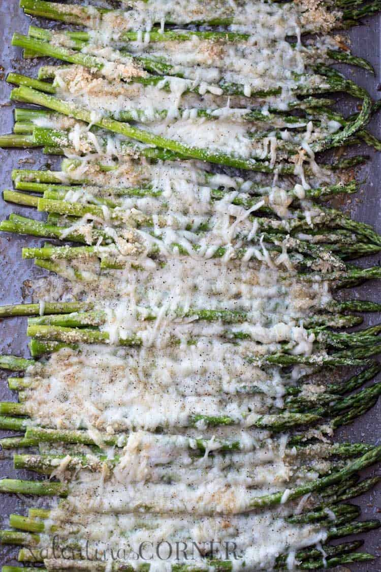 Cheesy baked asparagus recipe topped with Parmesan cheese and grated black pepper.