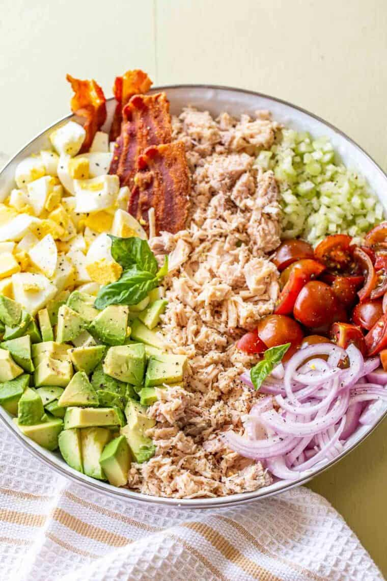 All the ingredients needed for the southern chicken salad in a white plate.