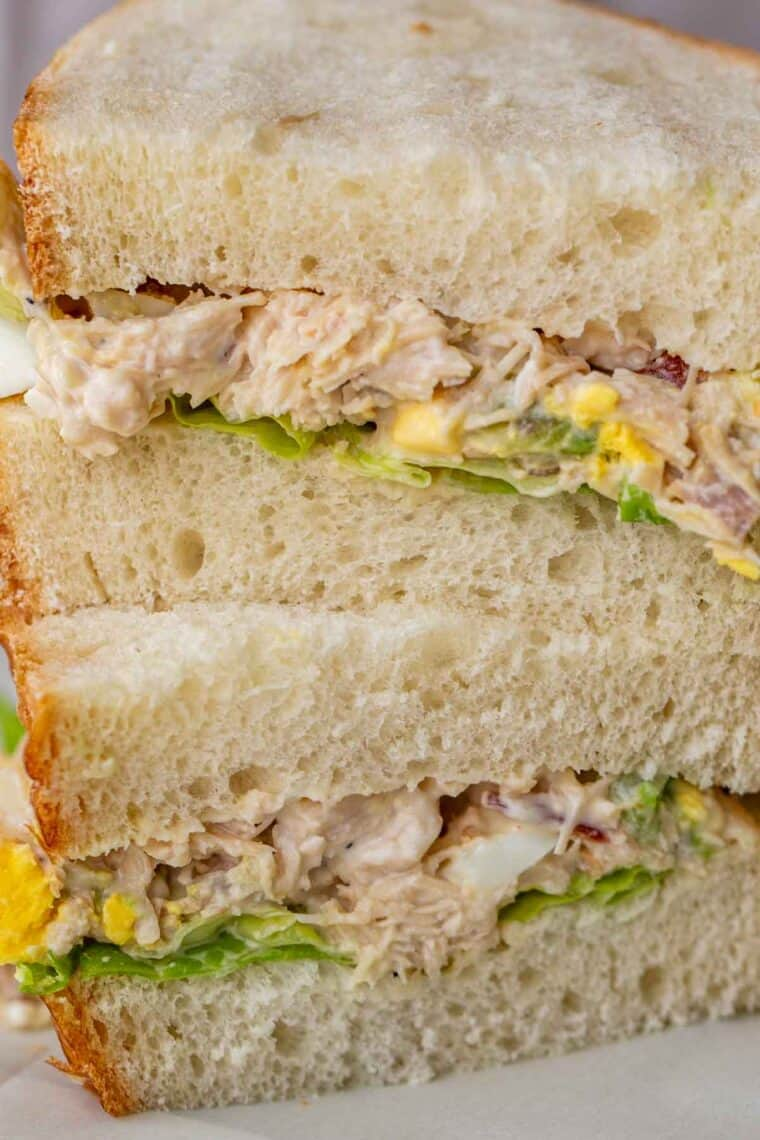 Chicken salad sandwich stacked on top of each other.