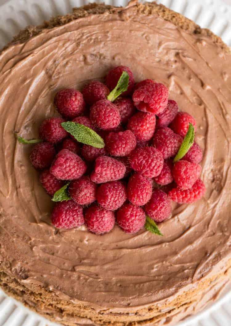 Chocolate layered sponge cake with fresh raspberries and a Nutella cream.