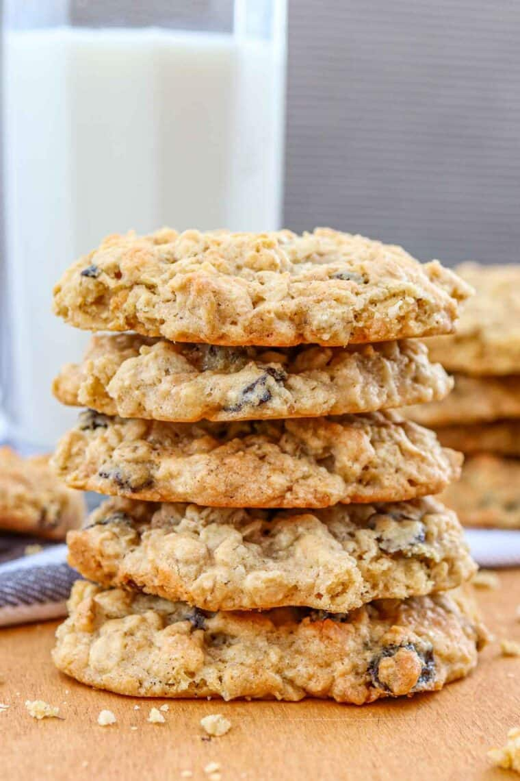 Soft coconut oatmeal raisin cookies stacked on top of each other.