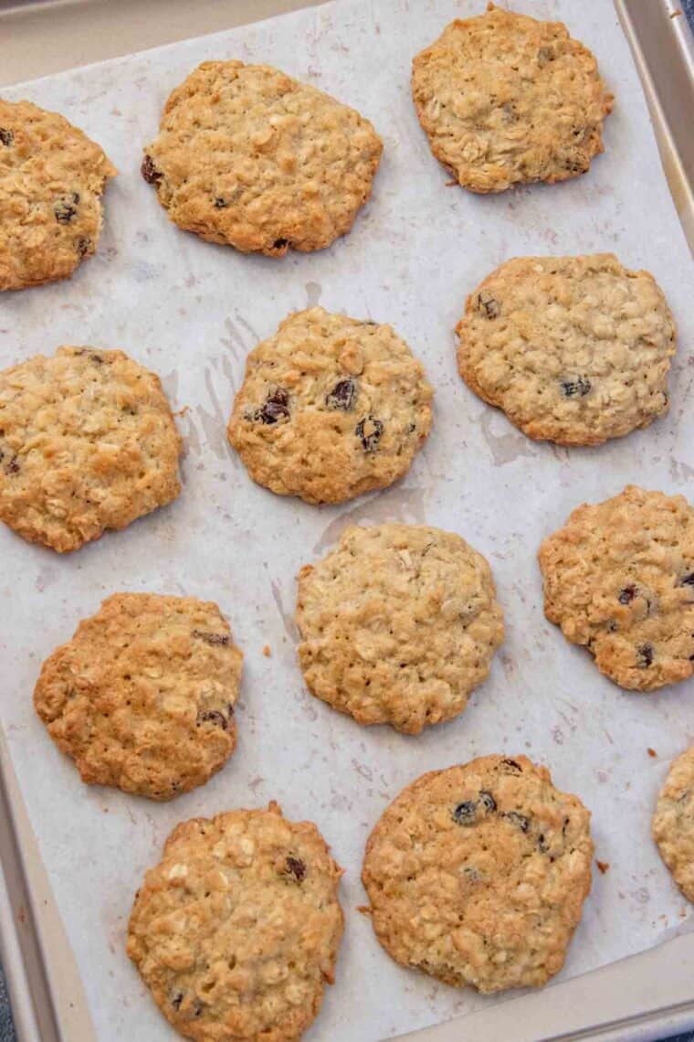 Oatmeal cookies laid out on a baking sheet.