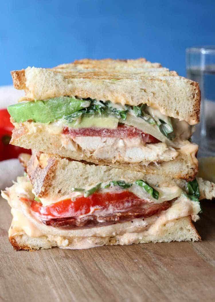 Panini cut in half, stacked on top of each other with the inside of the panini showing.