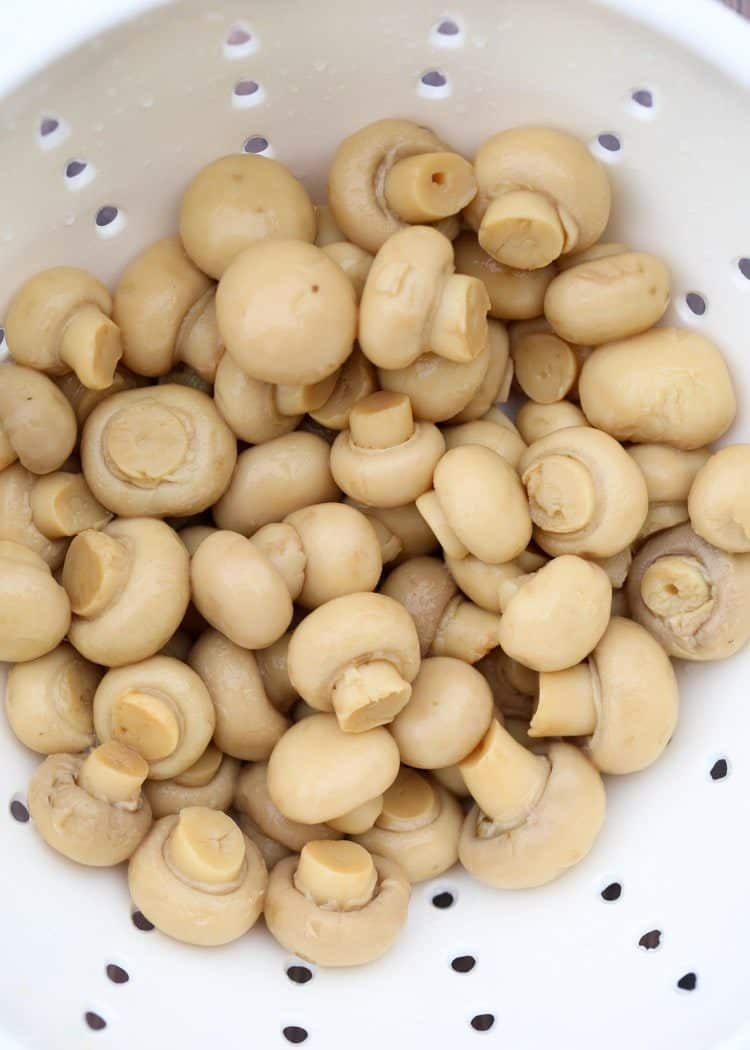 How to prepare mushrooms for this marinated mushroom salad.