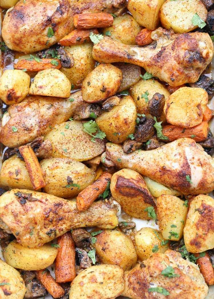 One Pan baked chicken legs, potatoes and vegetables recipe.