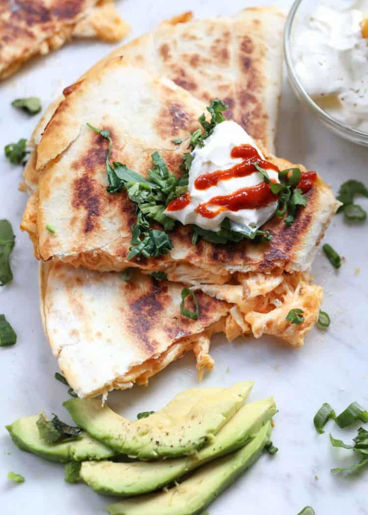 The easier recipe for chicken quesadillas with a 5-minute prep time. Serve the quesadillas with avocados and sour cream.