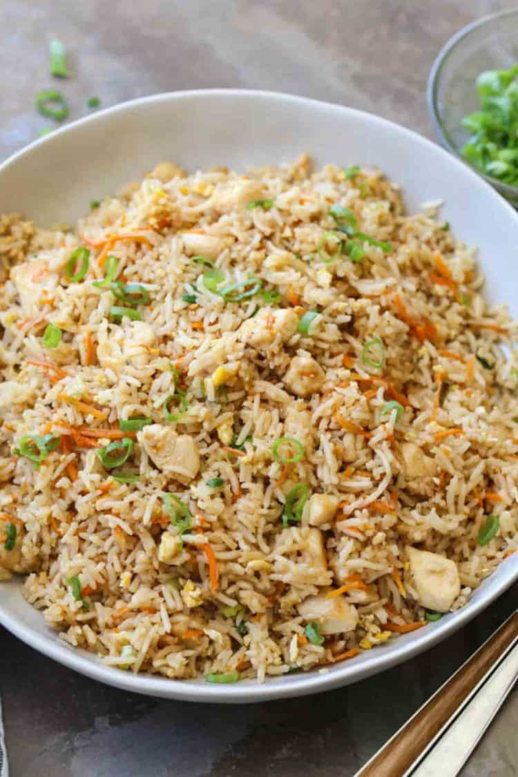 Easy chicken fried rice in a bowl topped with green onion.