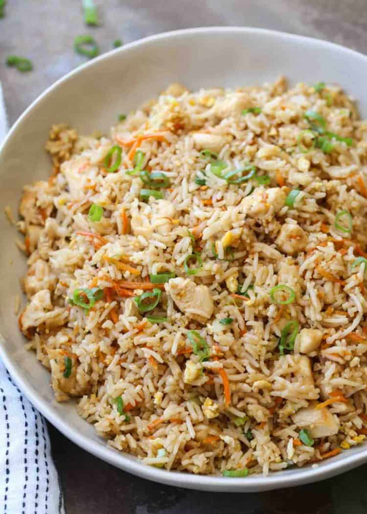Chicken with fried rice in a dish.