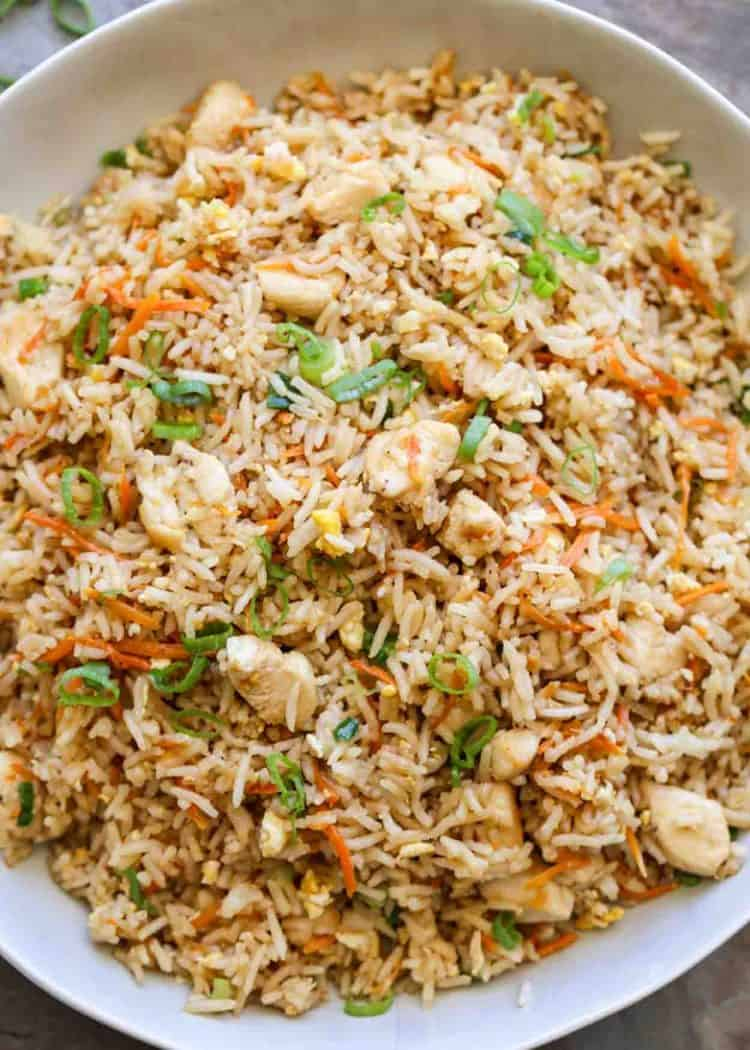 Fried rice recipe in a bowl with green onion.