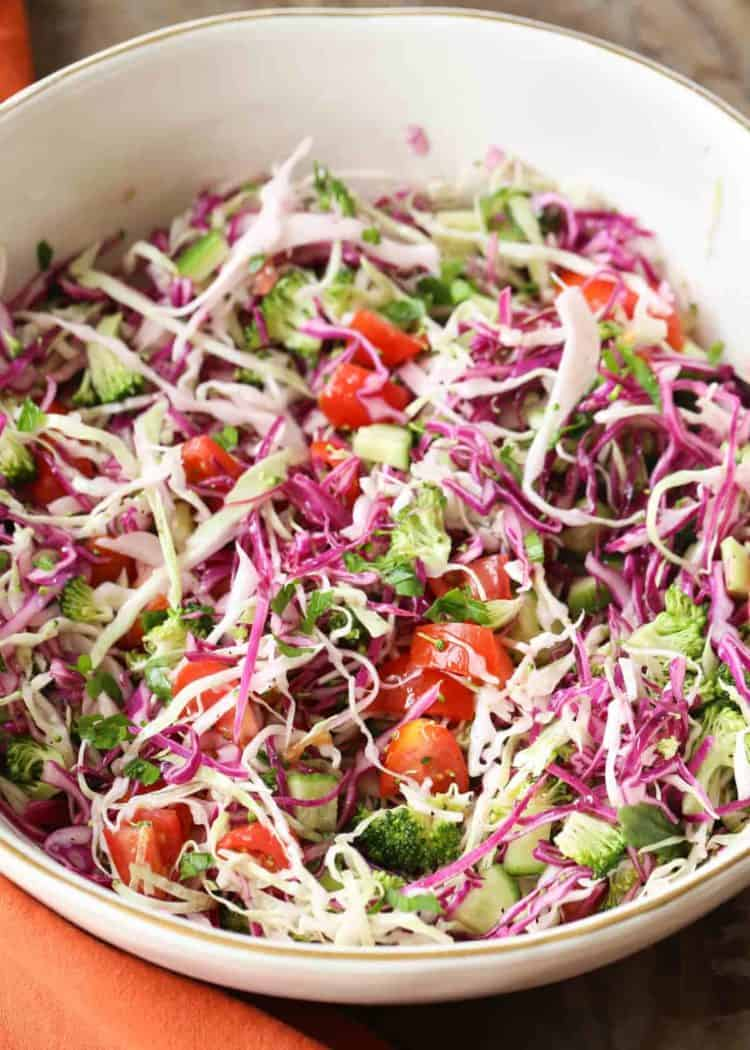 Broccoli cabbage salad with tomatoes and cucumbers.