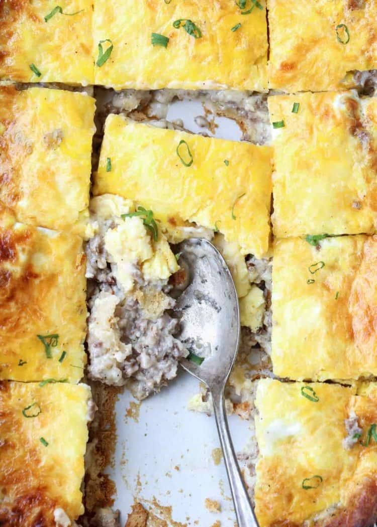 Breakfast casserole recipe in a casserole dish with a spoon.