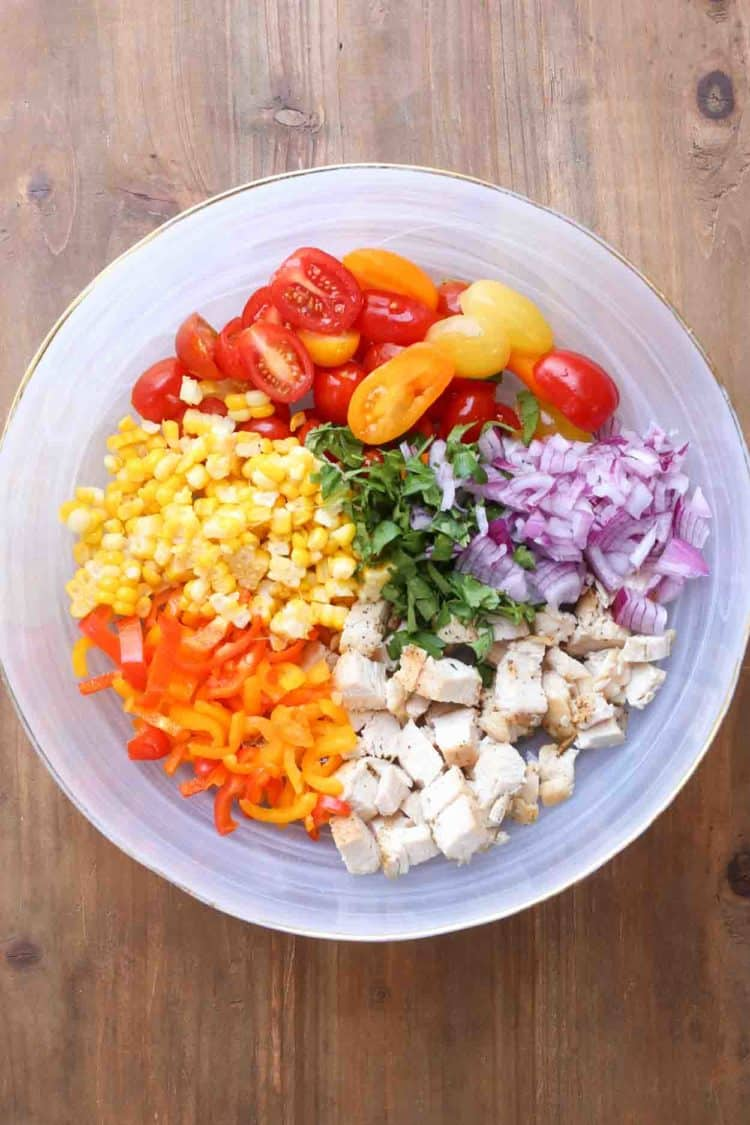 Vegetable chicken salad in a bowl with all the ingredients.