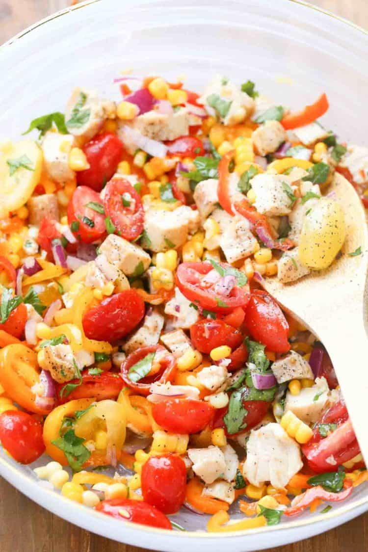 Mexican salad recipe in a bowl with a spoon.