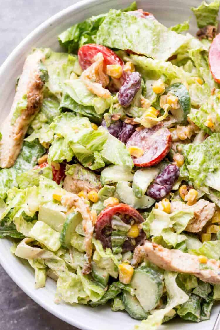 BBQ ranch chicken salad recipe in a bowl mixed with a homemade BBQ ranch dressing.