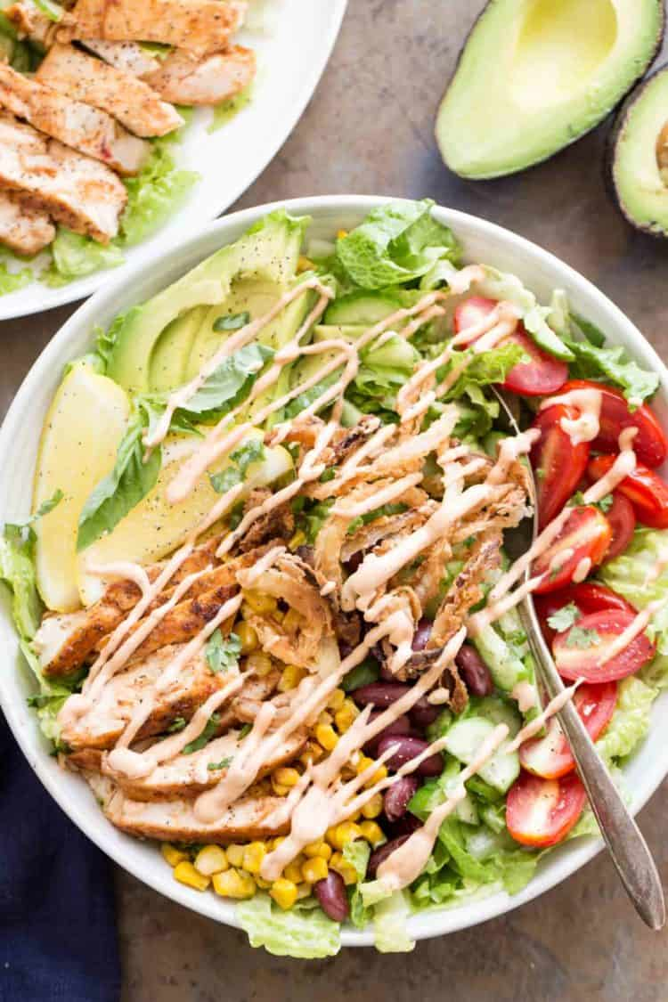Chicken salad recipe with a homemade BBQ ranch dressing drizzled on top.