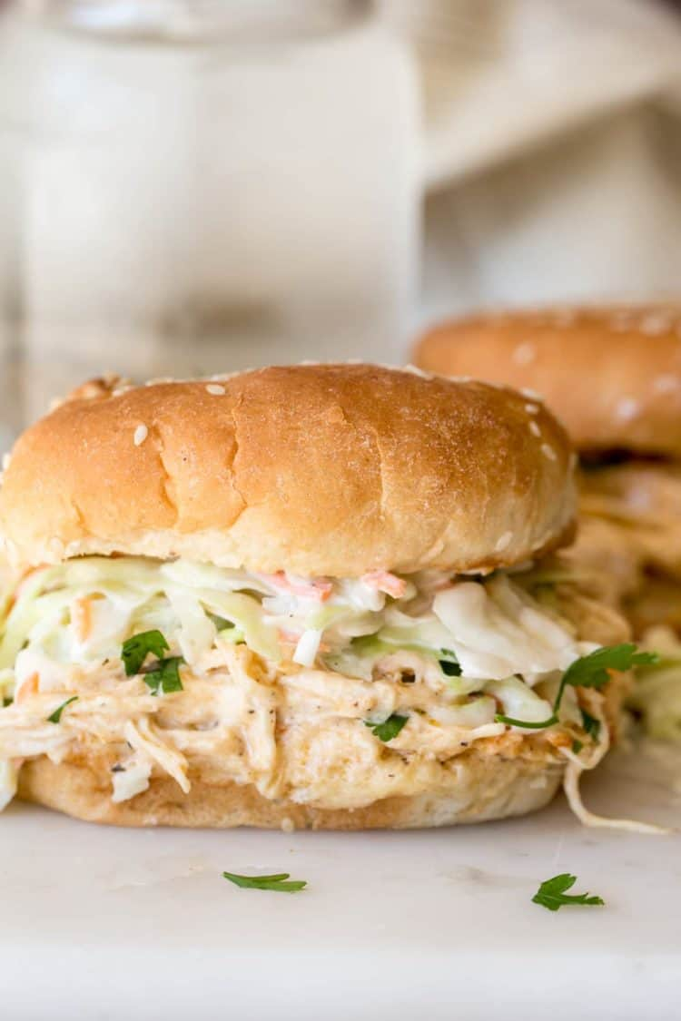 Instant Pot Crack Chicken Recipe made with chicken breast, cream cheese, and cheese. Served best as a sandwich.