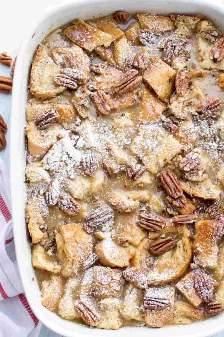 Maple Pecan Breakfast Casserole in a baking dish dusted with powdered sugar.