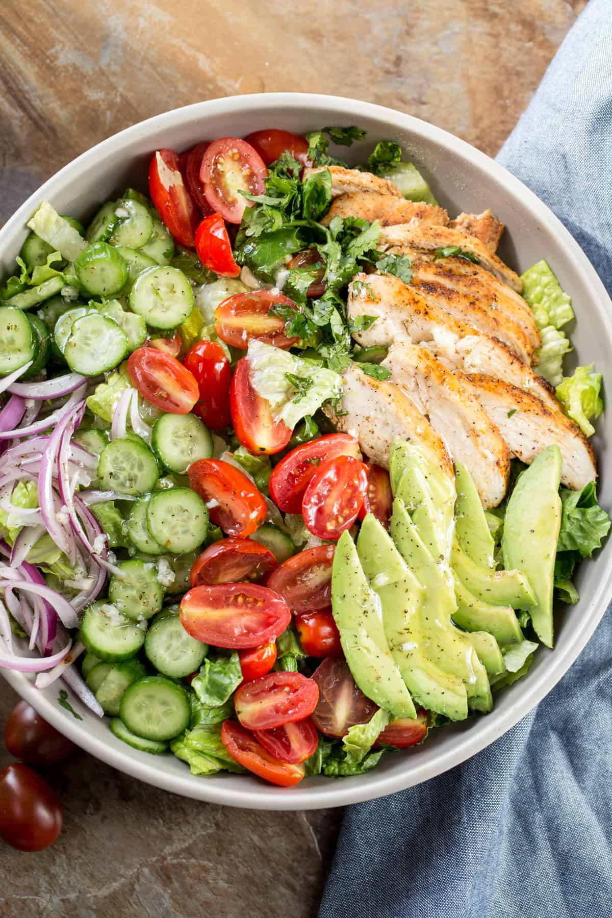 Romaine avocado chicken salad recipe topped with homemade oil and lemon dressing.