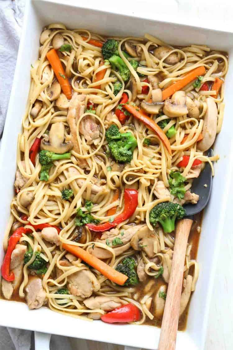 Chicken Stir Fry Recipe in a casserole dish with broccoli, peppers and carrots.
