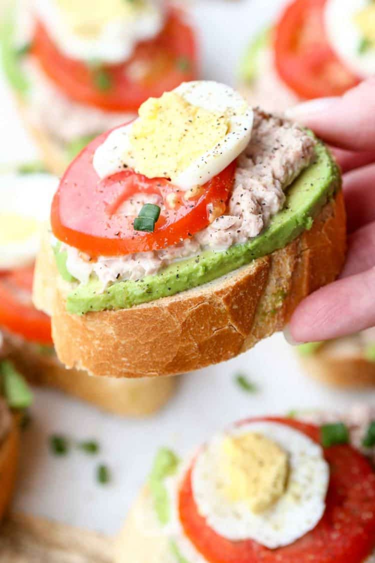 Upclose picture of avocado egg tuna sandwich.
