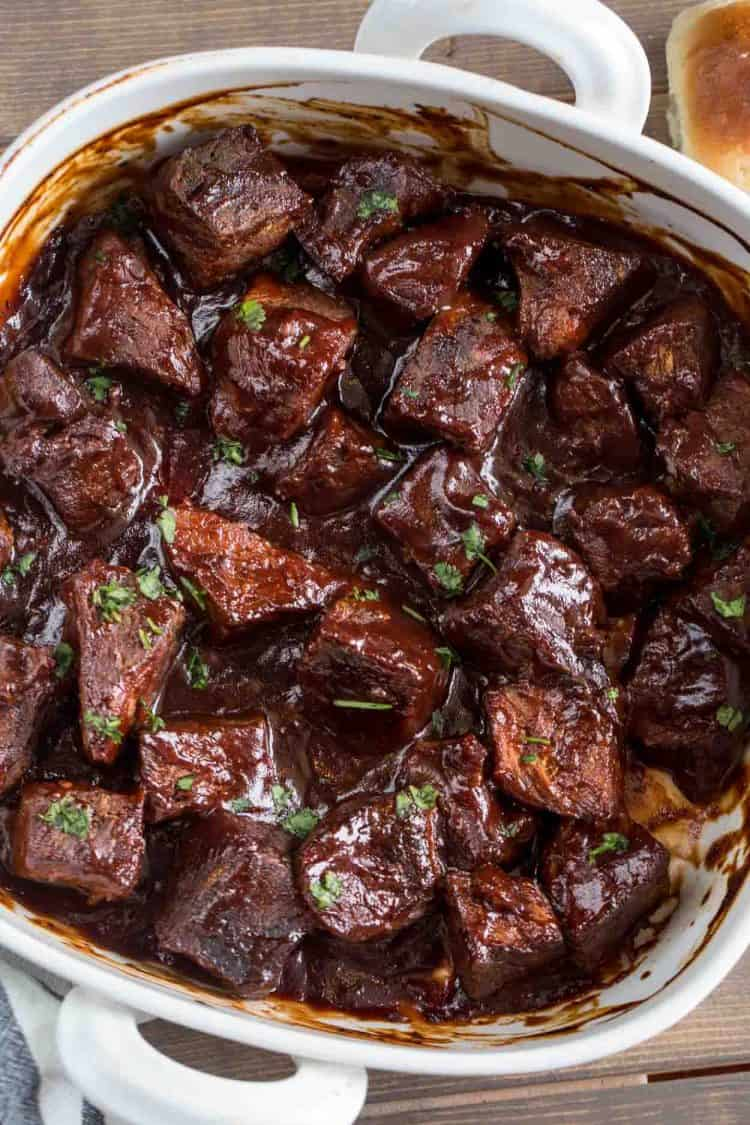 BBQ Crockpot Roast with a tangy barbecue sauce, topped with greens.