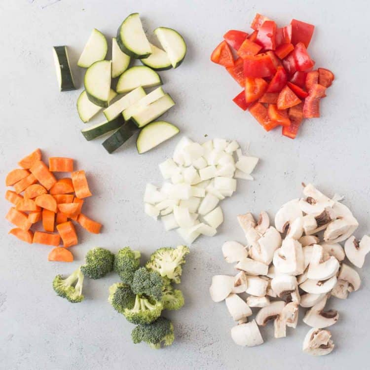 How to cut the carrots, broccoli, zucchini, peppers, mushrooms and onions for this easy chicken stir fry recipe.