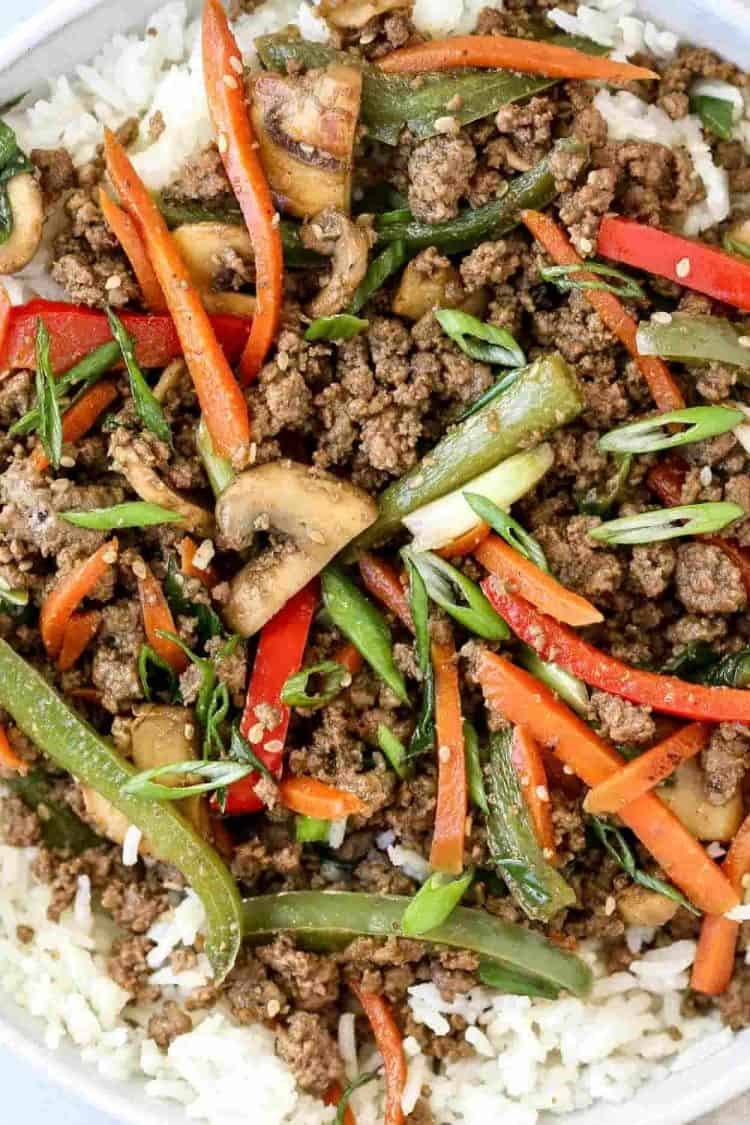 Simple ground beef stir fry with carrots, peppers and mushrooms.