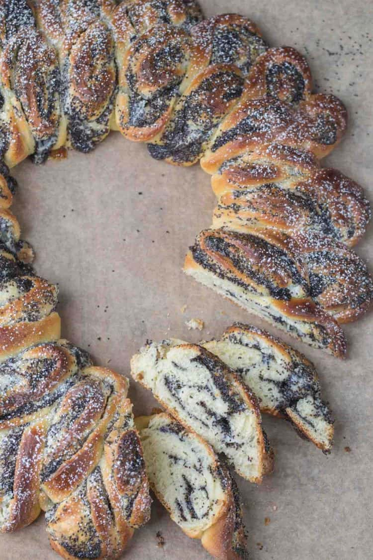 Poppy seed babka bread cut into pieces topped with powdered sugar.