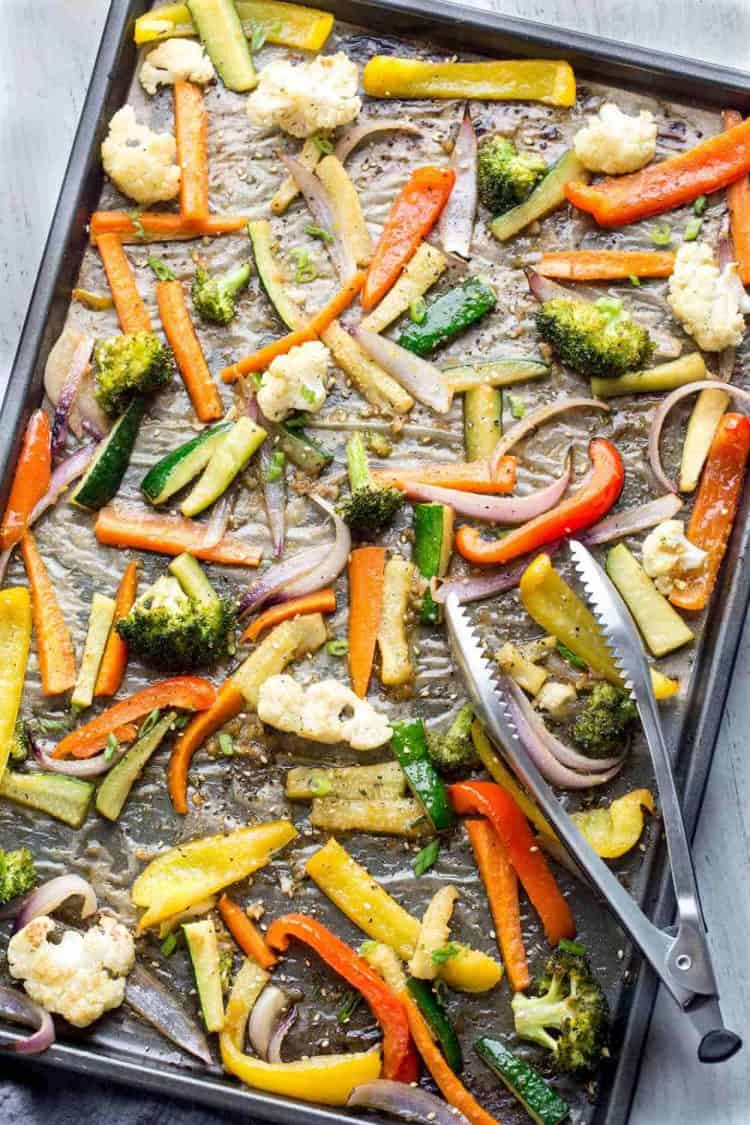 Roasted vegetables on a baking sheet, roasted into tender vegetables.