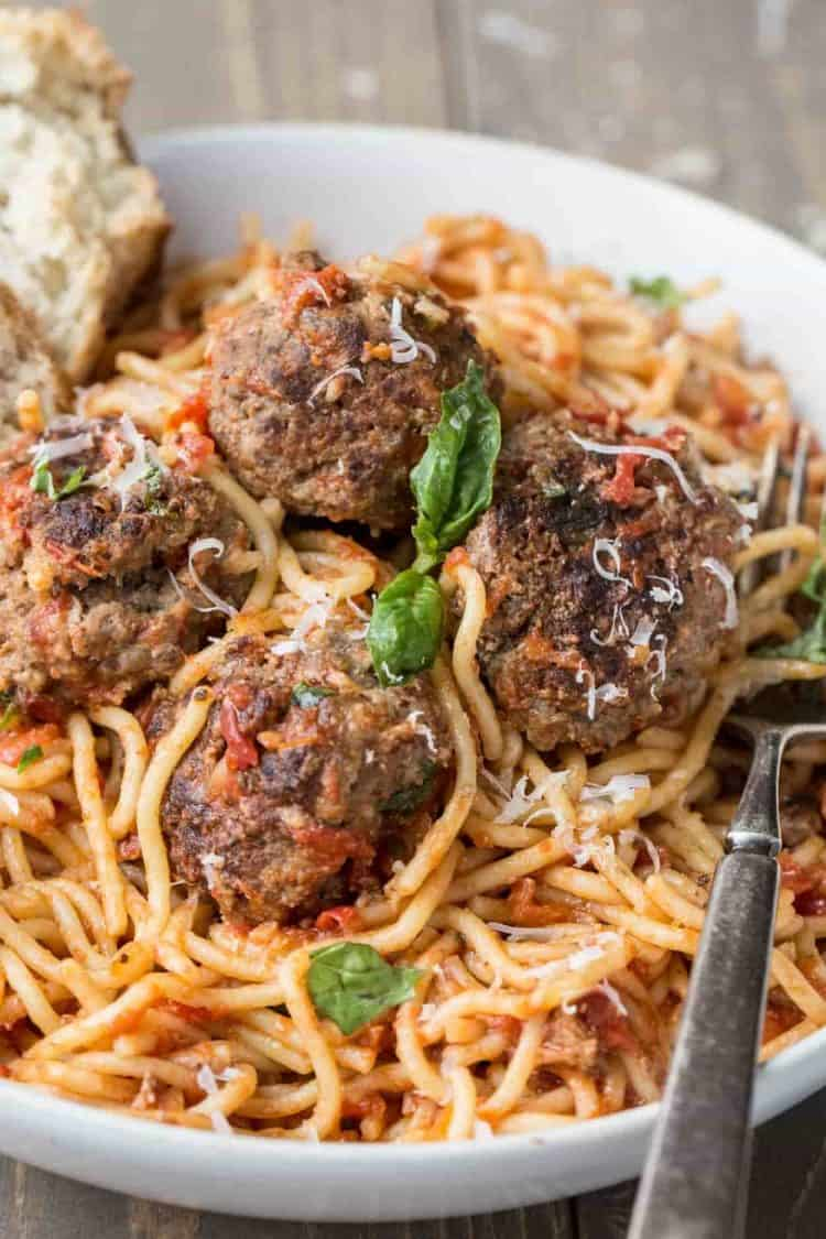 Easy spaghetti recipe made with a homemade juicy meaballs. Topped with fresh grated Parmesan cheese.