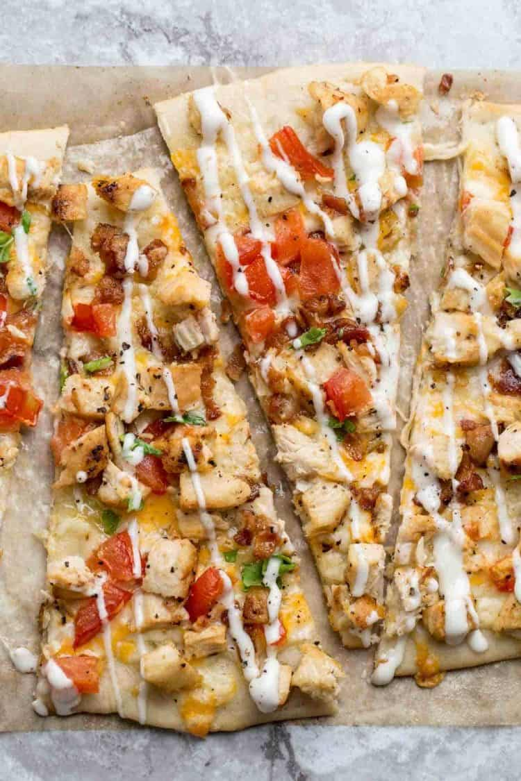 Thin and crispy flatbread crust topped with cheeses, chicken, bacon, avocado and drizzled with Ranch.