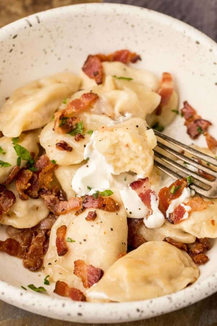 Pierogi recipe made with a cheesy potato and bacon filling.