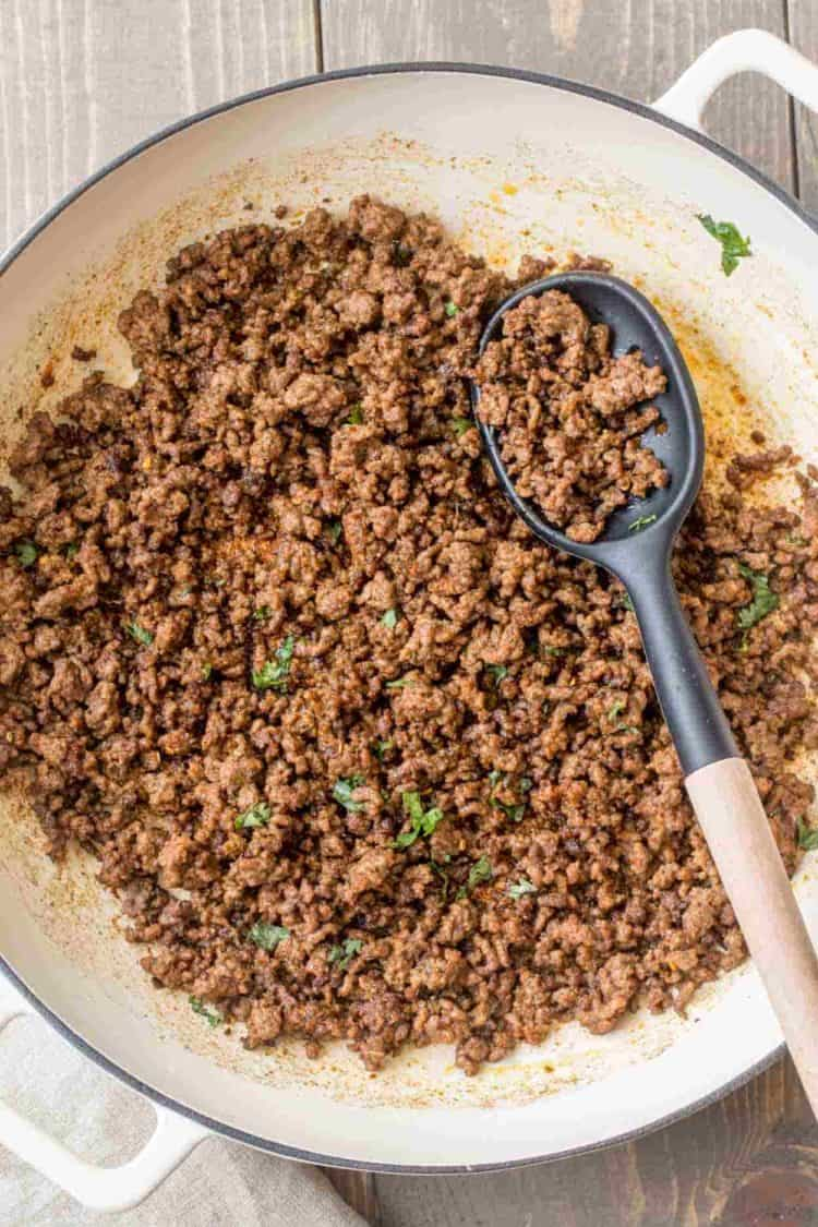 The best taco meat recipe in a skillet with a spoon.
