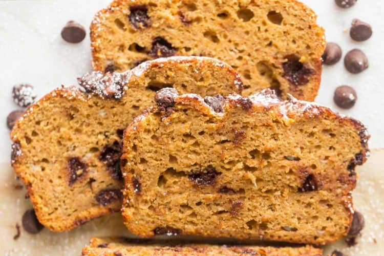 Slices of banana chocolate chip bread loaded with chocolate chips.
