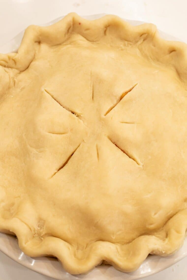 Homemade EASY pie crust recipe used to make a pie with crimped edges.