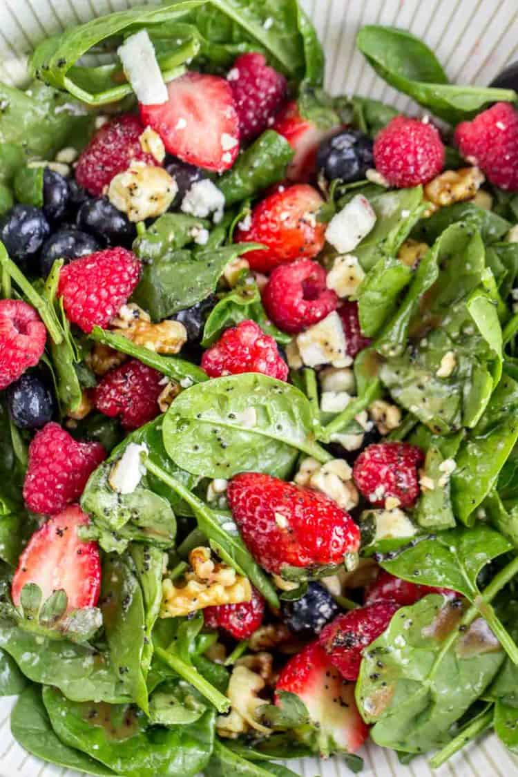 Strawberry spinach salad recipe tossed in a creamy poppy seed dressing.